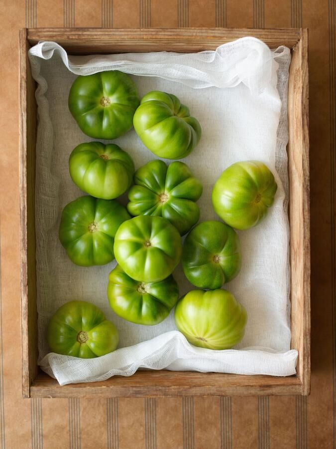 Green tomatoes in wooden box, overhead view. Image shot 2006. Exact date unknown.