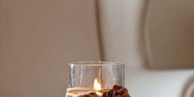 Pynta höstljus med skogsfynd