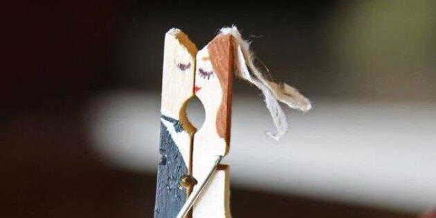 Kyssande brudpar av klädnypa