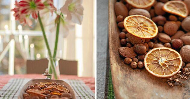 Juligt stilleben med nötter och doftande, torkade apelsinskivor.