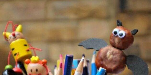 Dekorera pennan med en fladdermus av kastanjer