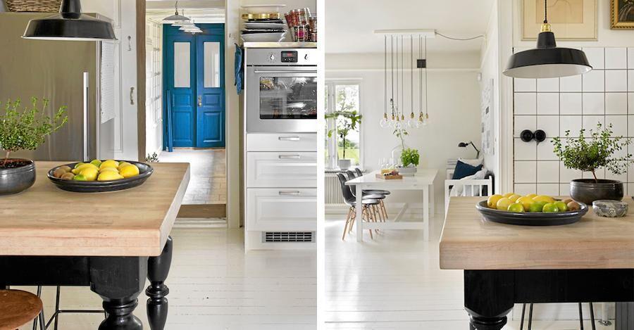 Köket ur två synvinklar, där de blå pardörrarna (Blocketfynd) bryter av mot det ljusa.