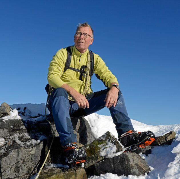Pär Axelstjerna tar rast högt upp på Kebnekaise, berget han besökt många gånger.