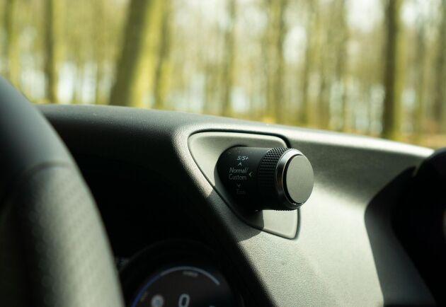Med körlägesväljaren växlar du mellan Eco, Normal och Sport.