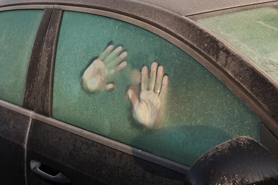 EC7H0P hand print like foot prints melted frost on window to car idea of trapped inside surviving cold spell call for help sunrise