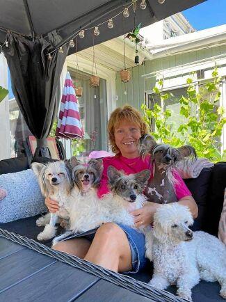 Marie Lind är i dag 18 kilo lättare och diabetesfri. Det ger henne ork och lust att leka med hundarna och barnbarnet.