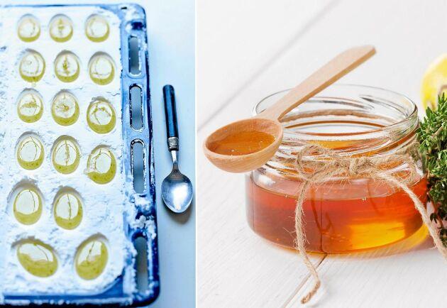 Små droppar av honung och örter som ligger i gropar i majsstärkelse.